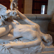 Statue of naked supine woman and winged, clawed demon crouched on her