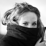 Girl with coat collar over lower face