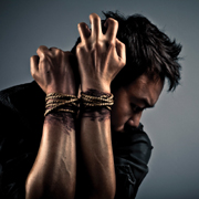 Man struggling with tied wrists